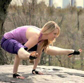 Yoga-Paws girl on rock